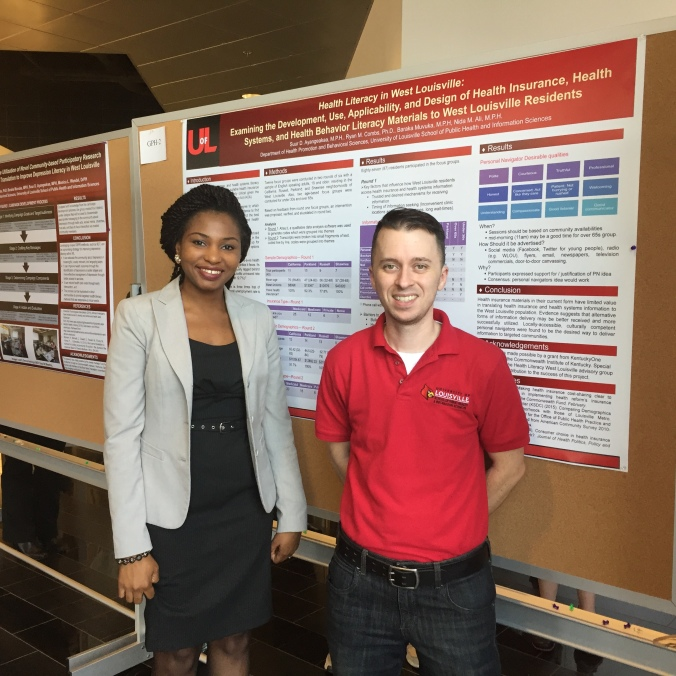 Ph.D. student Suur Ayangeakaa and Dr. Ryan Combs presenting a poster at Research!Louisville