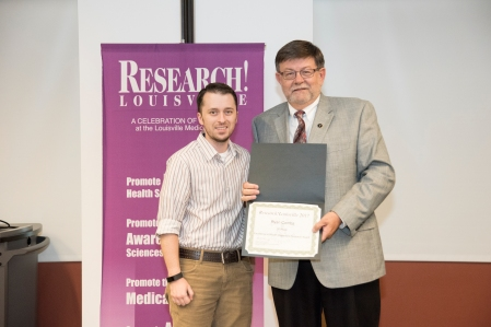 Ryan Combs, Ph.D., MA receiving his award