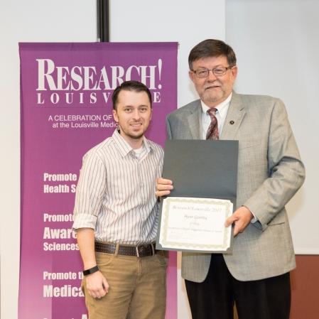 Ryan Combs, Ph.D., MA receiving his award